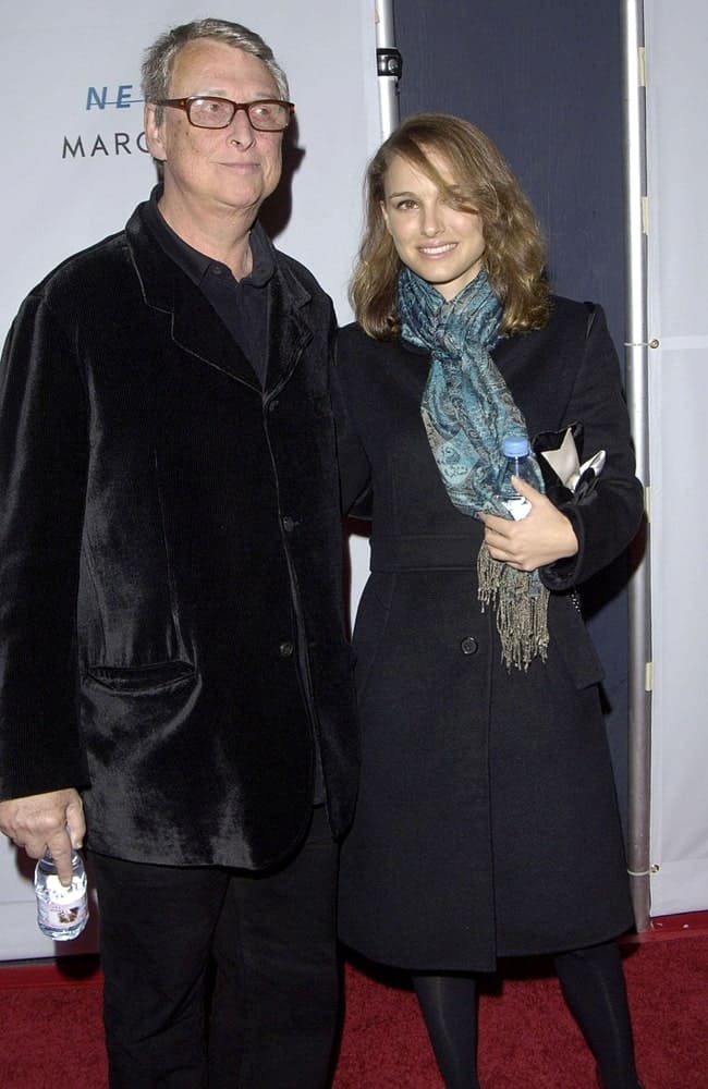 Mike Nichols and Natalie Portman were at the YOUNG FRANKENSTEIN Opening Night on Broadway at the Hilton Theatre, New York, NY on November 08, 2007. She wore a scarf and black coat with her loose brown shoulder-length hairstyle with side-swept bangs and a slight tousle.