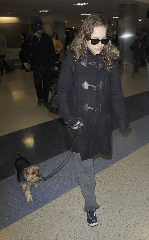 Best actress Academy Award winner Natalie Portman was seen with her dog at LAX airport on February 22, 2010 in Los Angeles, California. She wore a large black coat to pair her casual outfit and long tousled loose hairstyle.