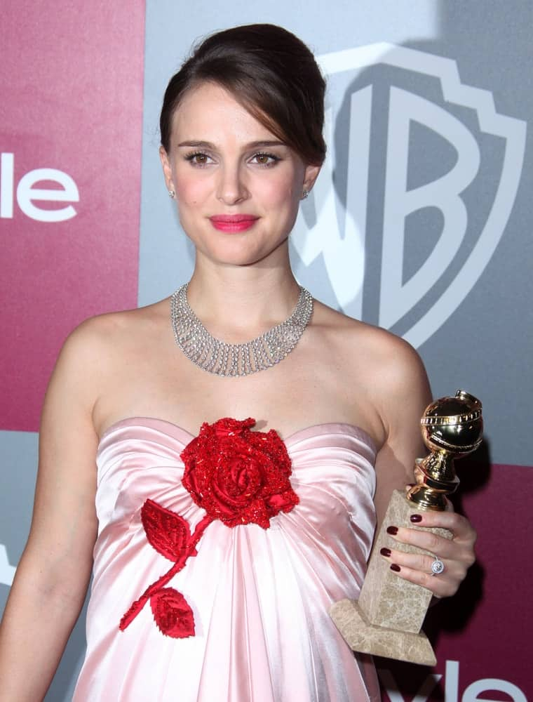 Natalie Portman flaunted her gorgeous diamond necklace with her floral strapless dress and upstyle bun hair that has side-swept bangs at  the 12th Annual WB-In Style Golden Globe After Party on January 16, 2011 in Beverly Hills CA.