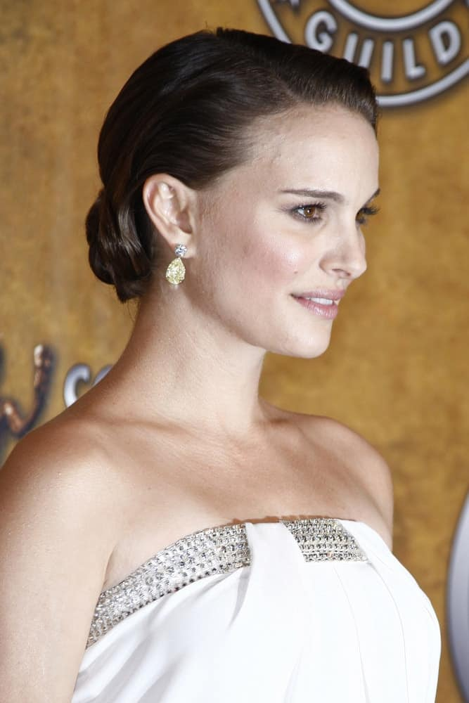 Natalie Portman was quite stunning in her white strapless dress with jewels and slick dark hair swept up in a low bun in the press room at The 17th Annual SAG Awards held at the Shrine Auditorium in Los Angeles, California on January 30, 2011.