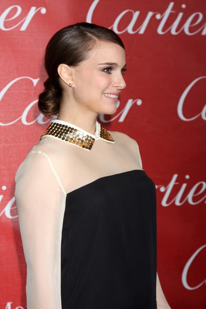 Natalie Portman arrived at the Palm Springs International Film Festival 2011 Awards Gala at Palm Springs Convention Center on January 8, 2011 in Palm Springs, CA. She paired her lovely sheer blouse with a slick and highlighted low bun hairstyle.