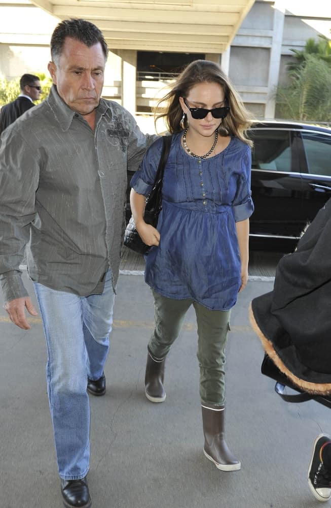 Actress Natalie Portman was seen at LAX on February 7, 2011 in Los Angeles, California. She paired her casual outfit with a pair of cool sunglasses and loose brunette hairstyle with a tousled side-swept finish.