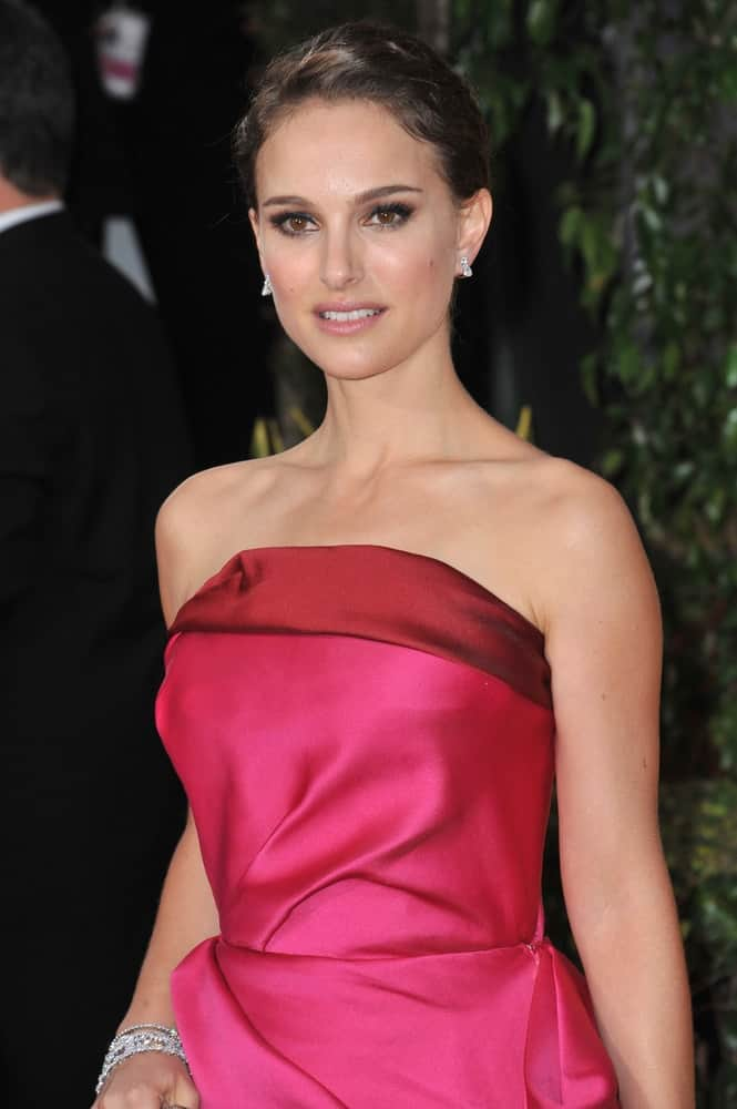 Natalie Portman flaunted her elegant neckline with her strapless pink dress and simple tousled upstyle at the 69th Golden Globe Awards at the Beverly Hilton Hotel on January 15, 2012 in Beverly Hills, CA.
