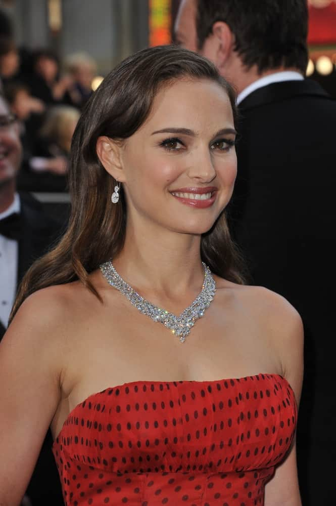 Natalie Portman's gorgeous diamond necklace were on full display with her polka-dotted red dress and loose side-swept hairstyle with highlights at the 84th Annual Academy Awards at the Hollywood & Highland Theatre, Hollywood on February 26, 2012 Los Angeles, CA.