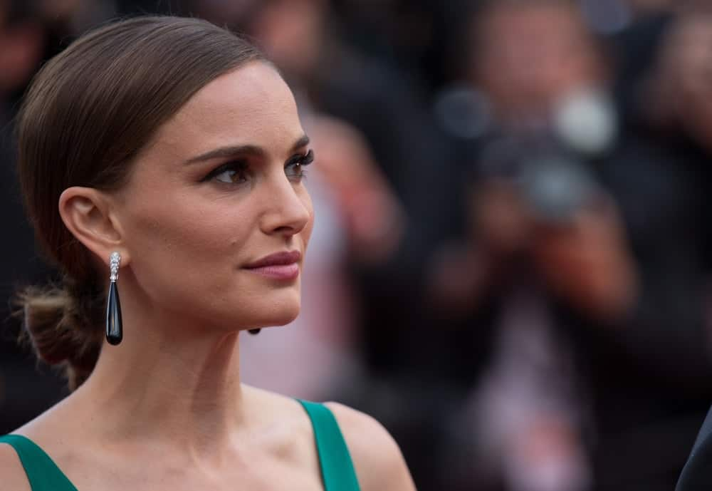Natalie Portman and guests attended the 'Sicario' Premiere during the 68th annual Cannes Film Festival on May 19, 2015 in Cannes, France. She paired her green dress and gorgeous black earrings with a charming dark low bun hairstyle.