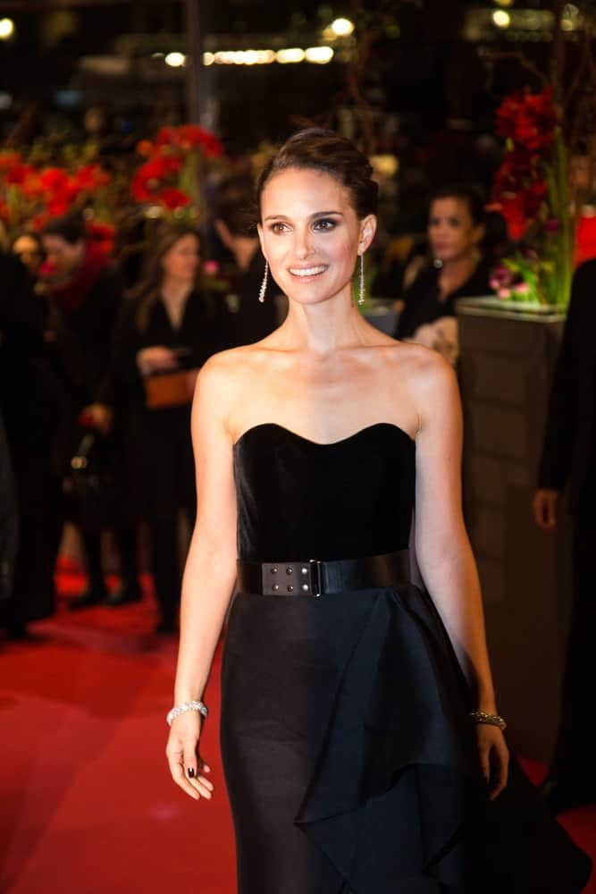 Actress Natalie Portman showed her beautiful smile with her simple make-up, black strapless dress and tousled upstyle bun hair at the 'Knight of Cups' premiere at the 65th Berlinale International Film Festival at Berlinale Palace on February 8, 2015 in Berlin, Germany.