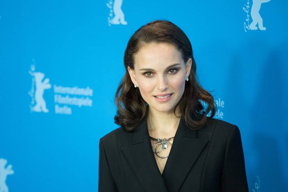 Natalie Portman's simple beauty was on full display with her black smart casual suit and wavy dark hairstyle that has a slick finish at the 'Knight of Cups' photocall in the 65th Berlinale International Film Festival at Grand Hyatt Hotel on February 8, 2015 in Berlin, Germany.