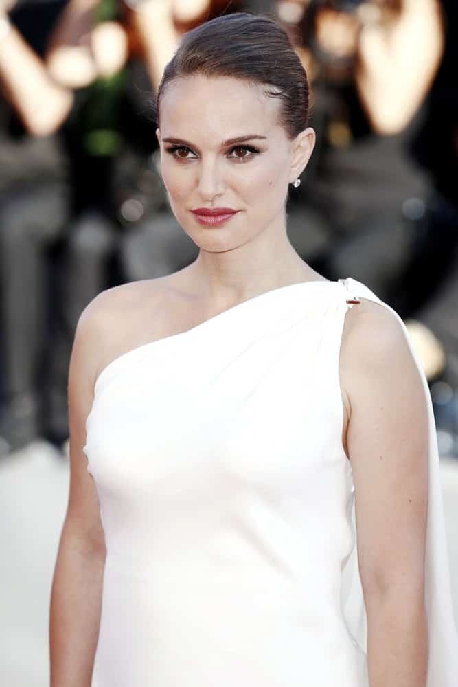 Natalie Portman was like a goddess in her white long dress and slick upstyle hair at the premiere of 'Planetarium' during the 73rd Venice Film Festival on September 8, 2016 in Venice, Italy.
