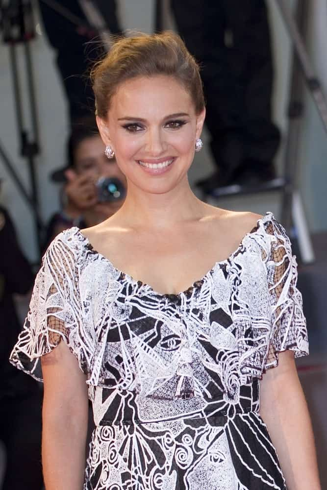 Natalie Portman flashed her beautiful smile that went well with her black and white dress and tousled upstyle bun hair at the premiere of 'Jackie' during the 73rd Venice Film Festival at Sala Grande on September 7, 2016 in Venice, Italy.