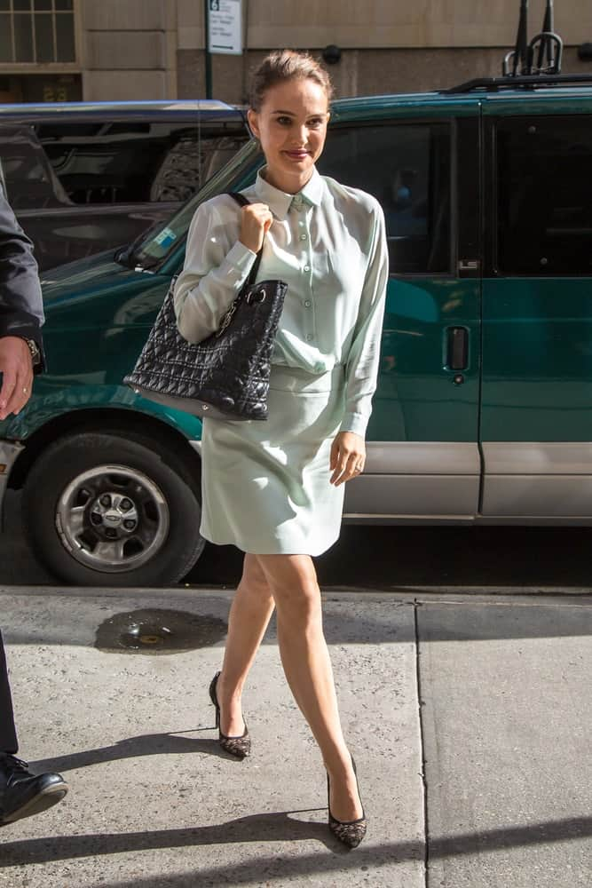 Natalie Portman wore an ensemble smart casual outfit with her black heels and neat bun hairstyle when she was seen walking the streets of Midtown, New York on August 15, 2016.