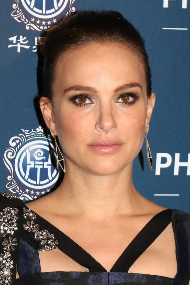 Natalie Portman wore a bejeweled dress to pair with her gorgeous earrings and slick dark hairstyle at the 21st Annual Huading Global Film Awards - Arrivals at The Theatre at The ACE Hotel on December 15, 2016 in Los Angeles, CA.