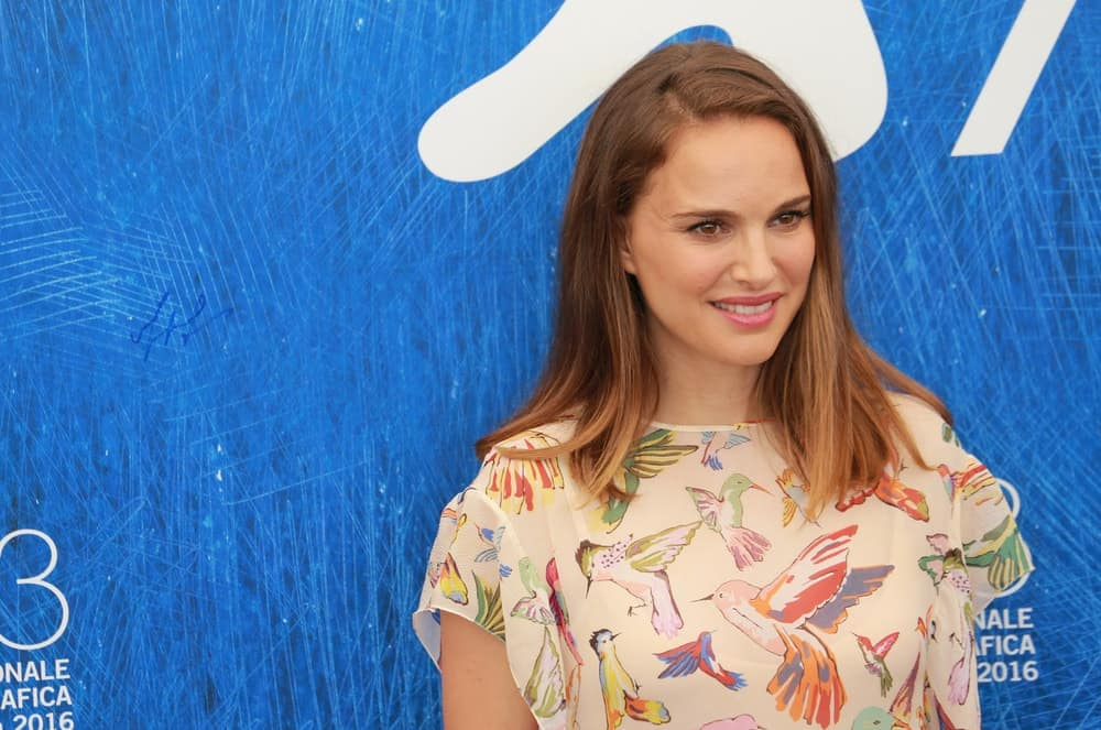 Natalie Portman attended the photocall of the movie 'Planetarium' during the 73rd Venice Film Festival on September 7, 2016. She wore a casual blouse with bird prints that went well with her medium-length brown hairstyle loose on her shoulders.