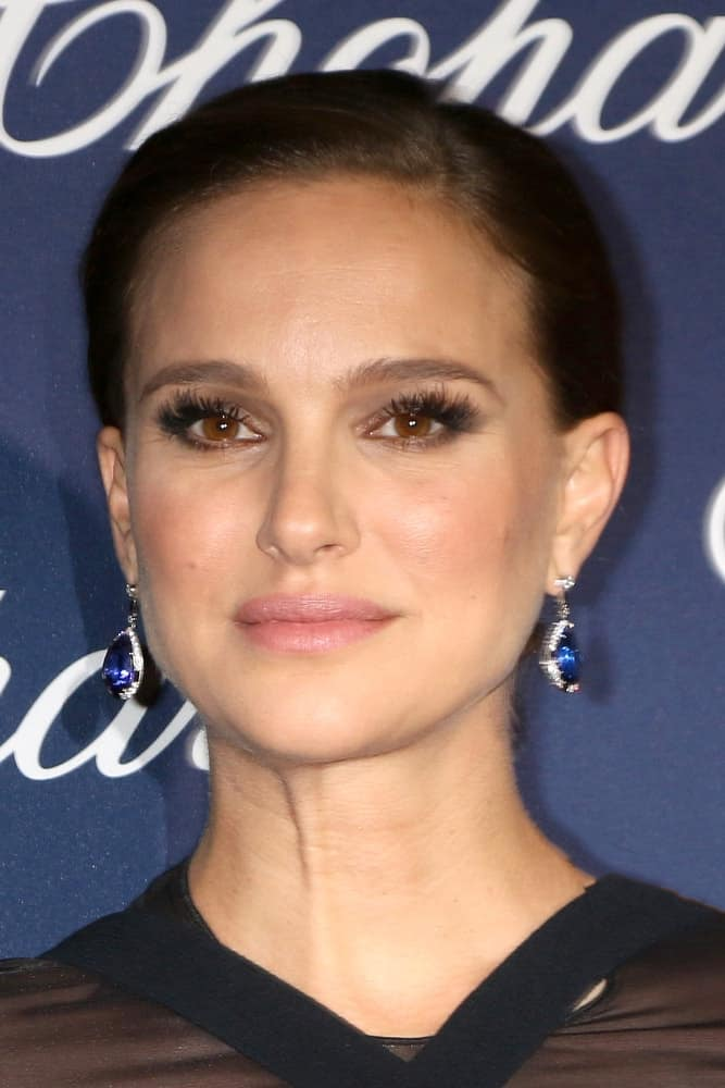 Natalie Portman's lovely blue earrings were on full display with her black dress and slick bun hairstyle at the Palm Springs International FIlm Festival Gala at Palm Springs Convention Center on January 2, 2017 in Palm Springs, CA.