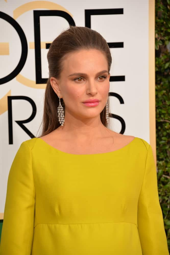 On January 8, 2017, Natalie Portman wore a mustard yellow dress with her slick half up hairstyle and charming make-up at the 74th Golden Globe Awards at The Beverly Hilton Hotel, Los Angeles.