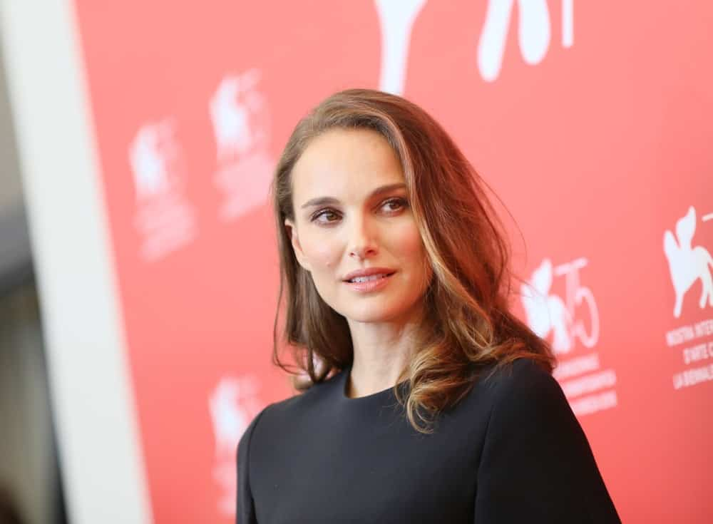 Natalie Portman was the picture of elegance and beauty in her black dress and loose side-swept medium length hairstyle with a light brown tone at the 'Vox Lux' photocall during the 75th Venice Film Festival on September 4, 2018 in Venice, Italy.