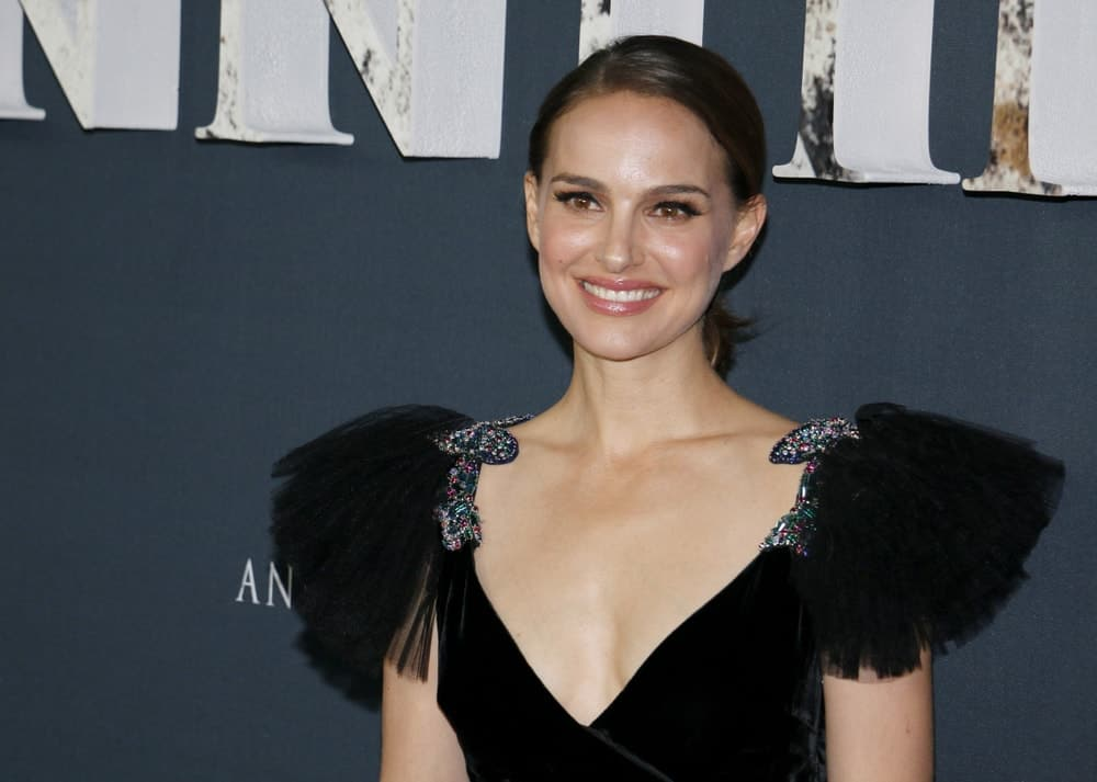 Natalie Portman wore a fashionable black dress with frills on the side to match her simple side-parted low ponytail and make-up at the Los Angeles premiere of 'Annihilation' held at the Regency Village Theater in Westwood, USA on February 13, 2018.