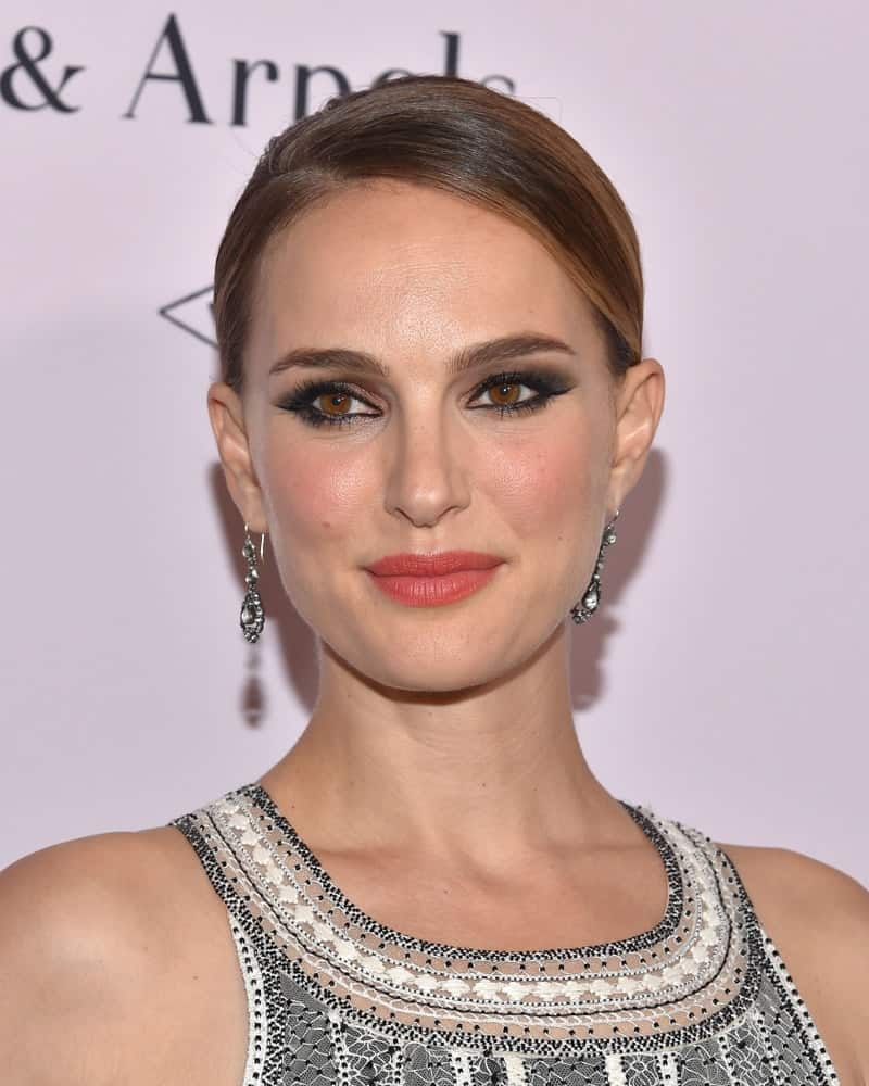 Natalie Portman attended the LA Dance Project Gala on October 19, 2019 in Los Angeles, CA. She wore a stylish and fashionable dress that she paired with an elegant and slick side-parted hairstyle with highlights.