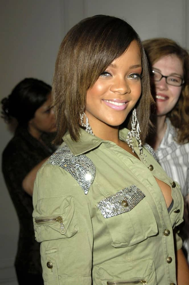 Rihanna wore an edgy and casual military jacket with her short bob hairstyle incorporated with long side-swept bangs at the press conference for the 33rd Annual AMA American Music Awards Nominations in Beverly Hills Hotel, Los Angeles, CA on September 20, 2005.