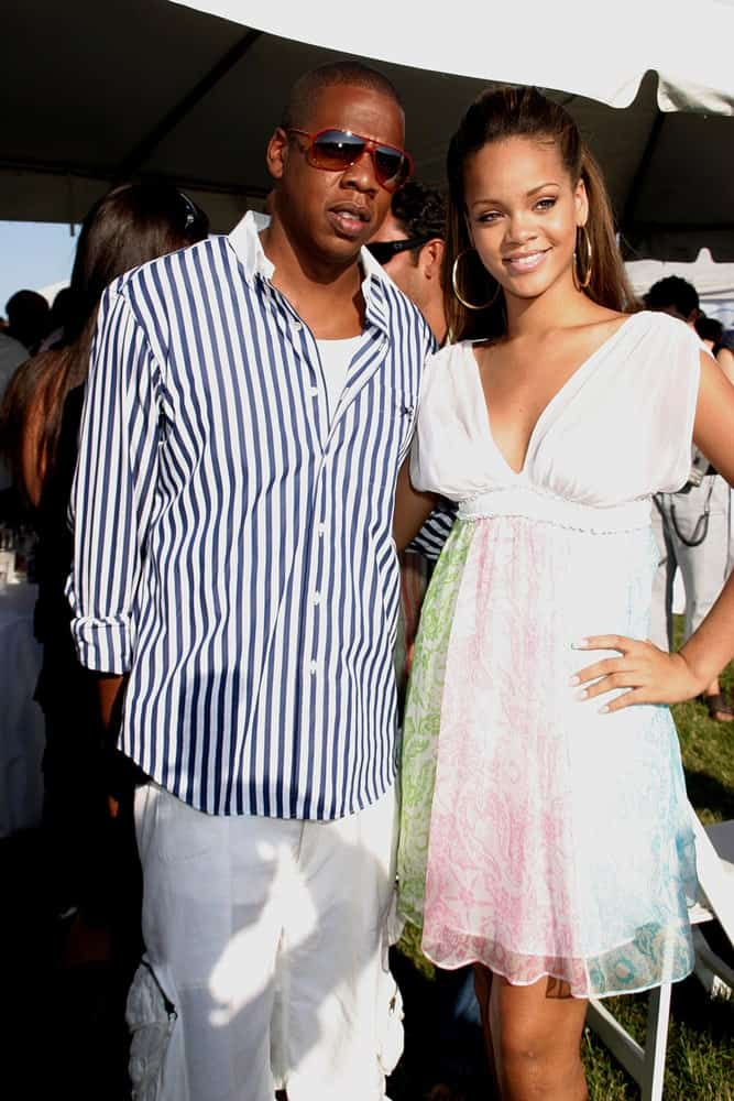 Jay Z and Rihanna were at the 2005 Mercedes-Benz Polo Challenge, The Bridgehampton Polo Club BPC in Bridgehampton, NY on July 23, 2005. She wore a lovely short sun dress with her long half-up brunette hairstyle.