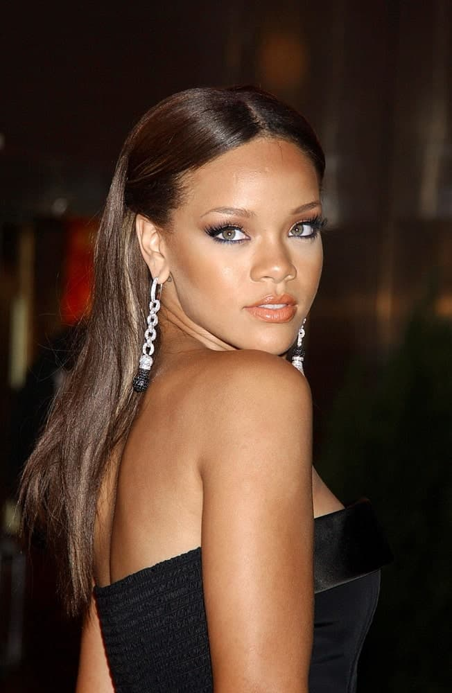 Rihanna was at the BMI Urban Music Awards at the Roseland Ballroom in New York, NY on August 30, 2006. SHe wore an elegant and stunning black strapless dress to pair with her long half-up hairstyle.