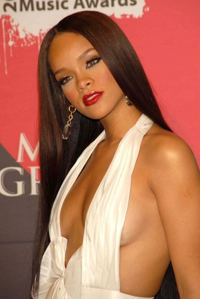 Rihanna was in the press room of the 2006 Billboard Music Awards at the MGM Grand Hotel on December 04, 2006 in Las Vegas, NV. She came wearing a sexy and stunning white dress to match her equally elegant straight long hair with subtle highlights.