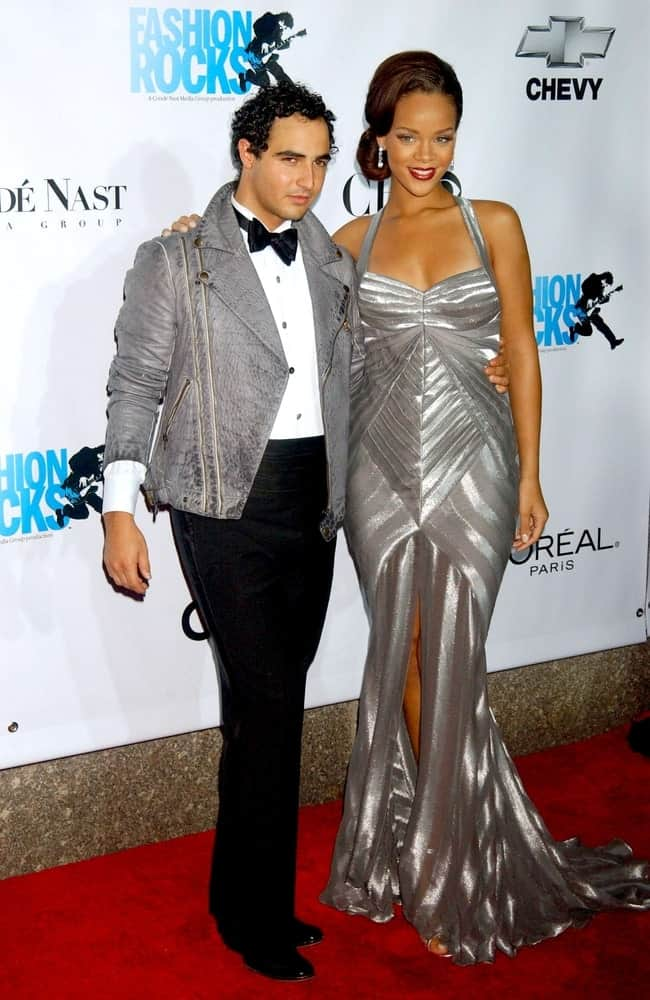 Zac Posen and Rihanna were at the Fashion Rocks Benefit Concert for Elton John AIDS Foundation, Radio City Music Hall at Rockefeller Center, New York on September 07, 2006. She was elegant in her silver dress and vintage low bun hairstyle with side-swept bangs.