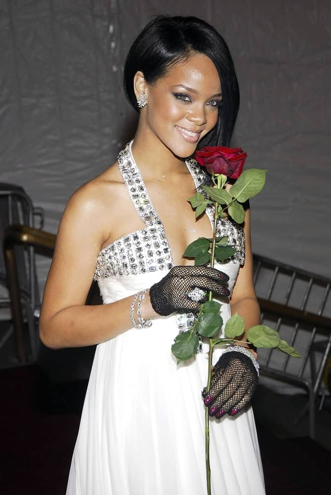 Rihanna wore a white jeweled dress with her side-swept bob hairstyle with long side-swept bangs at The Metropolitan Museum of Art Costume Institute Gala - Poiret King of Fashion, The Metropolitan Museum of Art in New York, NY on May 07, 2007.