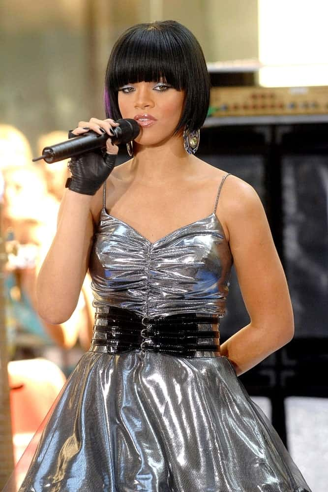 Rihanna was on stage for NBC Today Show Concert with Rihanna at the Rockefeller Center in New York, NY on June 08, 2007. She wore a charming silver dress that she paired with her raven straight short bob hairstyle with blunt bangs.