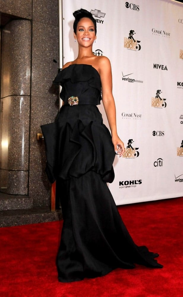 Rihanna was wearing a beautiful black Monique Lhuillier gown at the 5th Annual FASHION ROCKS Concert Hosted by Conde Nast at the Radio City Music Hall in New York, NY on September 05, 2008. SHe paired this with a slick pixie hair swept up for a slight pompadour style.