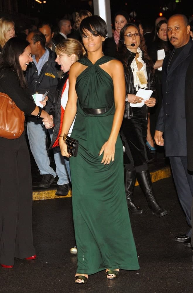 Rihanna was wearing an elegant green Gucci dress with her short and side-swept raven hairstyle with eye-skimmer bangs at A NIGHT TO BENEFIT RAISING MALAWI AND UNICEF hosted by Gucci in New York, NY on February 06, 2008.