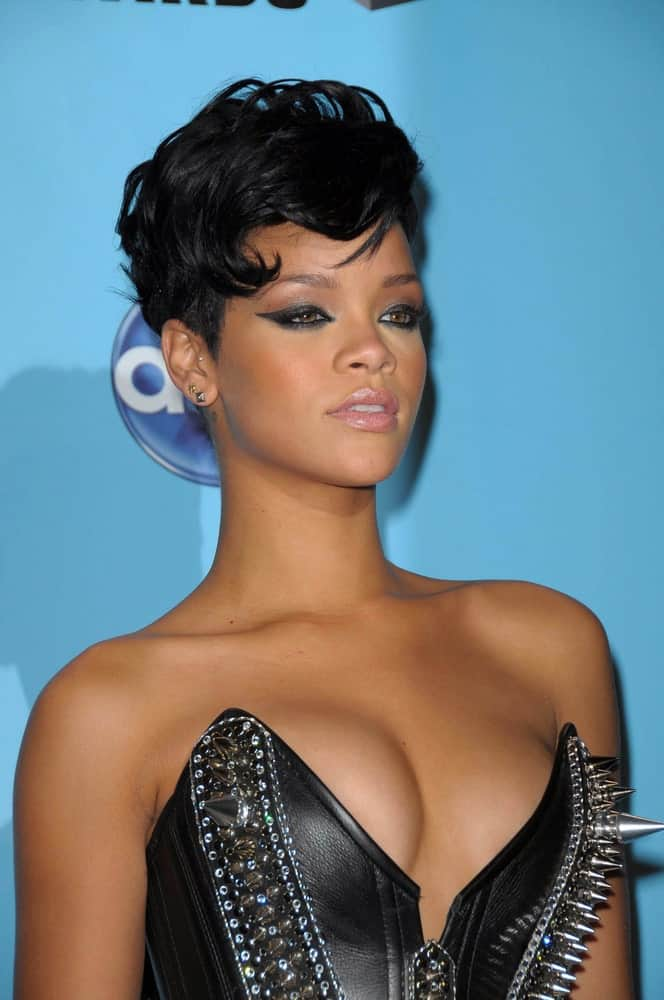 Rihanna looked edgy and cool in her spiked black leather bustier and raven pixie hair perfectly tousled for a wavy vintage look with a side-swept finish in the press room at the 2008 American Musica Awards in Los Angeles, CA.