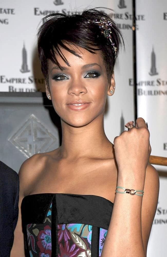 Rihanna wore a Cartier tiara and bracelet at the Empire State Building lighting, Empire State Building in New York on June 19, 2008. She was quite lovely and sweet in her colorful strapless outfit and raven pixie hairstyle with wispy bangs.