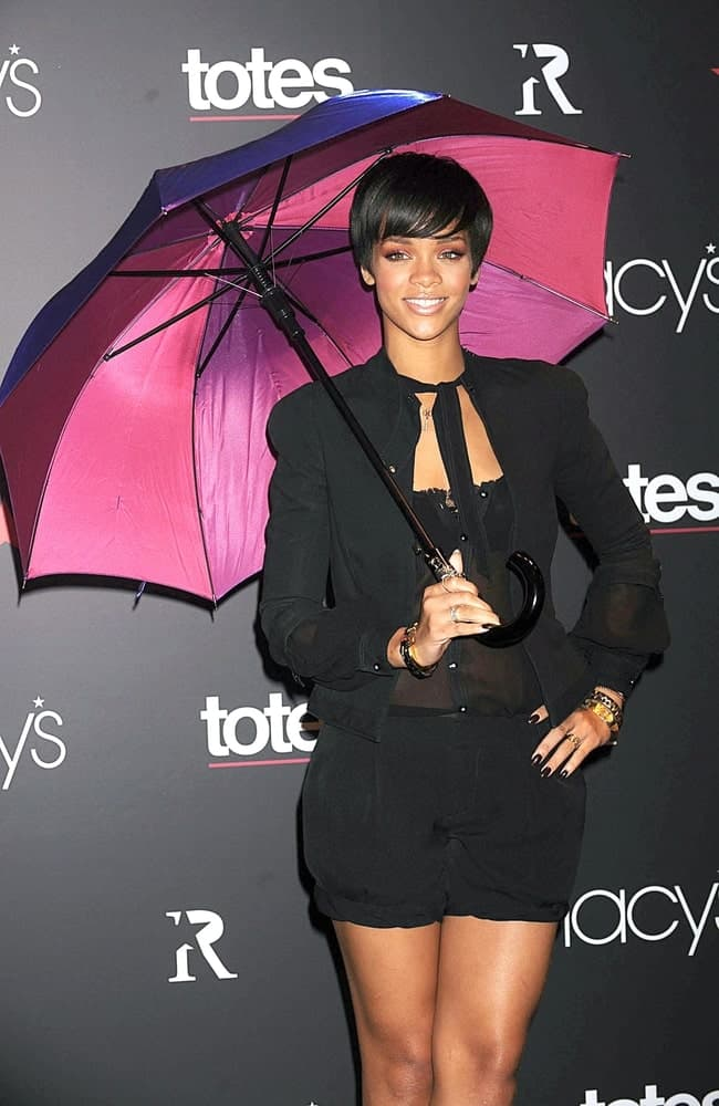 Rihanna wore a Matthew Williamson outfit at the Rihanna Umbrella Collection Launch by TOTES and MACY's held at the Macy's Herald Square Department Store in New York on February 05, 2008. She paired her black casual clothes with a simple pixie hairstyle with side-swept eye-skimmer bangs.