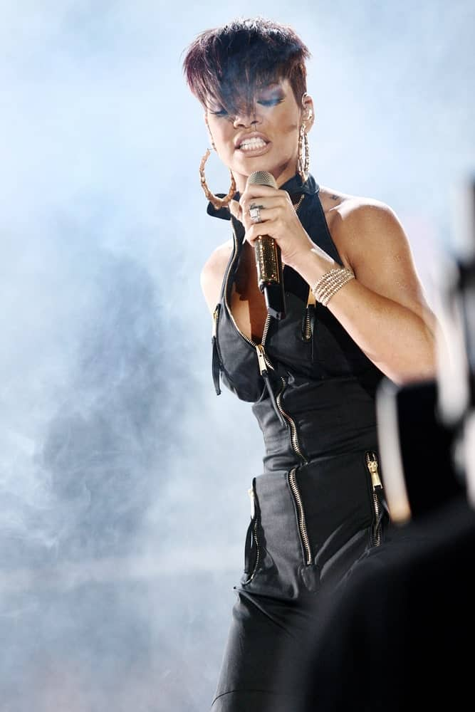 Rihanna performed at the MTV Mobile Bang Concert held at Milan Central Station on July 15, 2008 in Milan, Italy. She was cool in her black jumpsuit and pixie hairstyle with a shaved side and long and straight bangs.