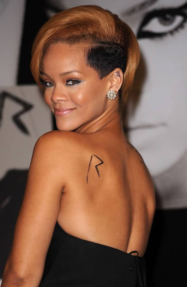 Rihanna at in-store appearance for Rihanna Promotes New Album RATED R at the Best Buy in New York City, NY on November 23, 2009. She flashed the fans with her lovely smile that worked quite well with her side-swept short hair with a shaved side.