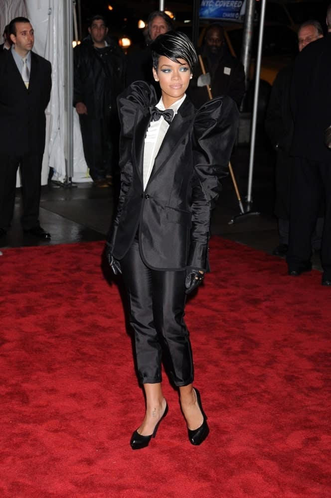 Rihanna went with an androgynous look in her Dolce & Gabbana suit and side-swept jet black pixie hairstyle at The Model as Muse Embodying Fashion Costume Institute Benefit Gala, Metropolitan Museum of Art, New York on May 4, 2009.