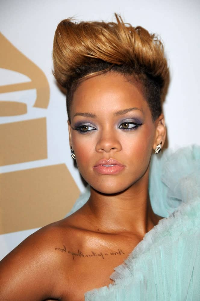 Rihanna wore a charming blue dress to pair with her edgy undercut pixie hair with highlights and a spiked pompadour finish at The Recording Academy and Clive Davis Present The 2010 Pre-Grammy Gala - Salute To Icons held at the Beverly Hilton Hotel in Beverly Hills, CA on January 30, 2010.