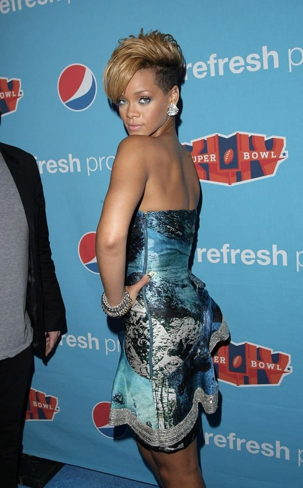 Rihanna wore a Christian Siriano dress at the Pepsi Refresh Project Superbowl Kickoff Party, LIV Nightclub at Fontainebleau Miami Beach, Miami, FL on February 5, 2010. She paired this dress with a sexy side-swept pixie hairstyle dyed sandy blond.