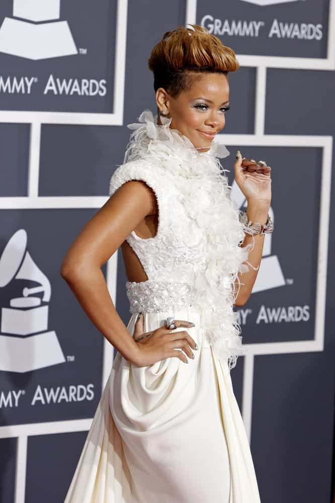Rihanna was at the 52nd Annual GRAMMY Awards held at Staples Center in Los Angeles, California on January 31, 2010. She was elegant in her white feathered dress that is fashionably paired with a tossed up pixie hairstyle with a slight pompadour finish.