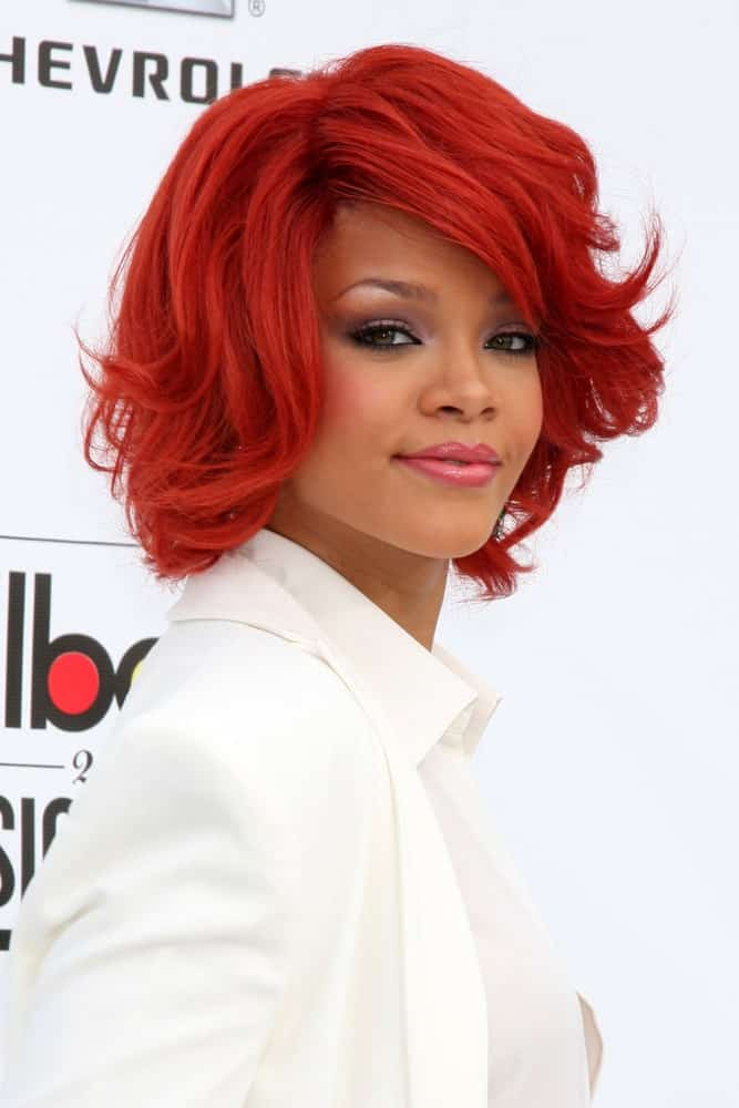 Rihanna was at the 2011 Billboard Music Awards at MGM Grand Garden Arena in Las Vegas, NV. She was lovely in her pure white outfit to contrast with her short tousled side-swept hairstyle that has a bright red tone.