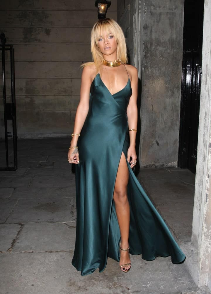 Rihanna attended the Stella McCartney Winter 2012 London Evening Wear Presentation and Dinner in London. She was quite fashionable in her dark green dress and medium-length blond hairstyle with eye-skimmer bangs.