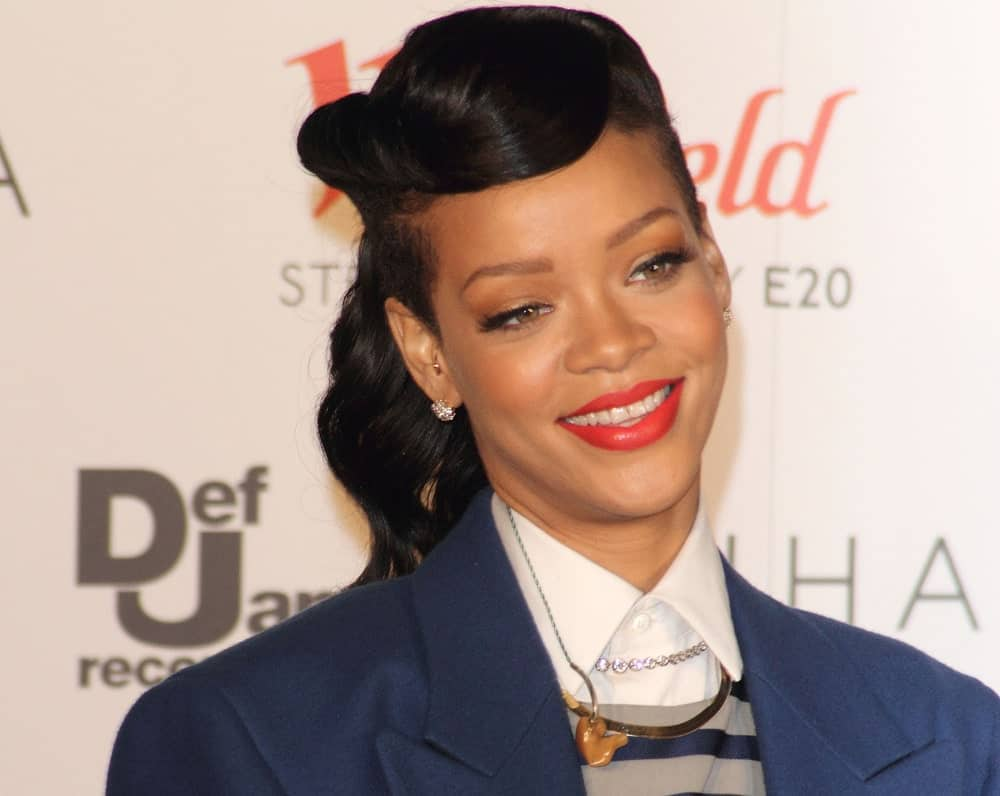 Rihanna wore a smart casual outfit with her ponytail hairstyle incorporated with side-swept bangs when she attended the Westfield Stratford City Christmas Lights Lighting Ceremony in Stratford, London on November 19, 2012.