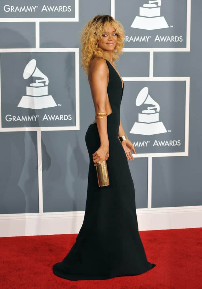 Rihanna was at the 54th Annual Grammy Awards at the Staples Centre in Los Angeles on February 12, 2012. She looked absolutely stunning in her black dress and her long and loose tousled curly hair that is dyed blond.