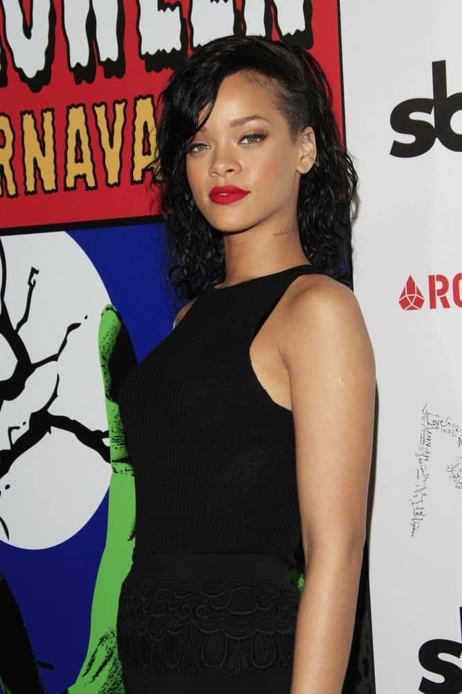 Rihanna was named the Queen of the 2012 West Hollywood Halloween Carneval at Greystone Manor Supperclub on October 31, 2012 in West Hollywood, California. She wore a black casual ensemble outfit with her shoulder-length raven curly hair with a shaved side.