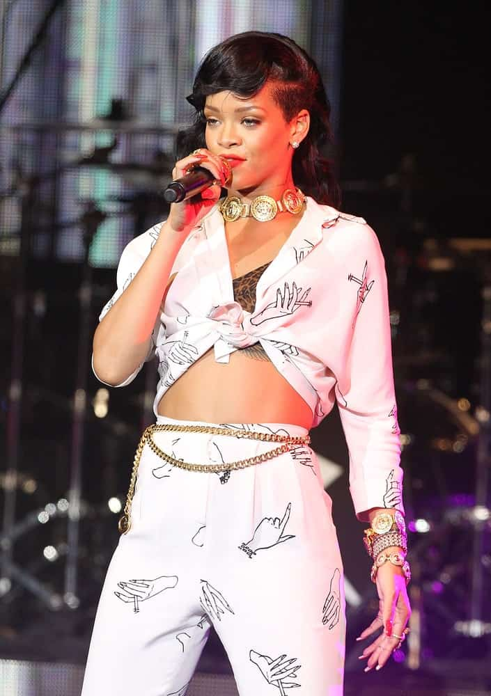 Singer Rihanna performed her 777 secret gig tour at the HMV Forum in Kentish Town in London on November 19, 2012. She was wearing a white ensemble outfit with her long and wavy raven hair styled with a shaved side and side-swept bangs.