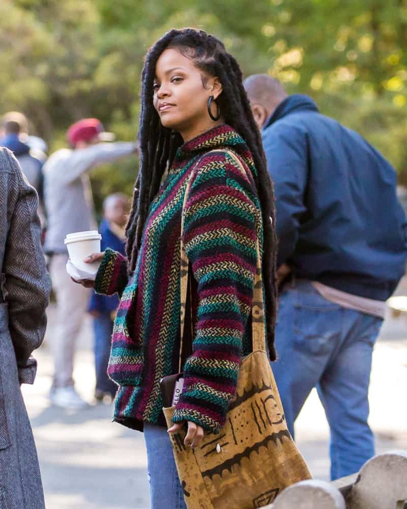 Rihanna was seen on the film set of 'Ocean's 8' in Central Park on November 9, 2016 in New York City. She was wearing casual clothes and her hair was styled into long side-swept dreadlocks.