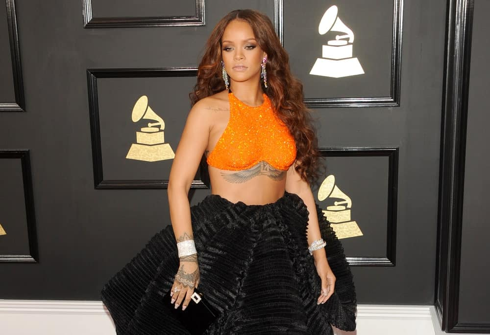 Rihanna attended the 59th GRAMMY Awards held at the Staples Center in Los Angeles, USA on February 12, 2017. She wowed everyone with her sexy two-piece outfit that showed off her figure and long wavy tousled hairstyle that has a reddish tone.