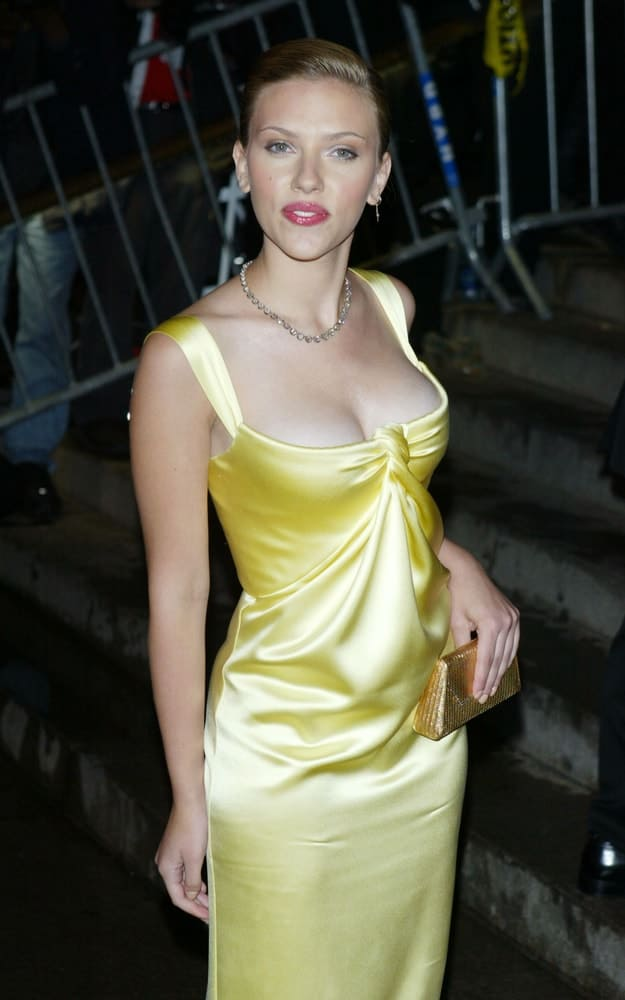Actress Scarlett Johansson wore a Calvin Klein dress when she arrived at the Costume Institute Party of the Year at the MET April 26, 2004 in New York City. She topped her golden dress with a slick bun hairstyle.