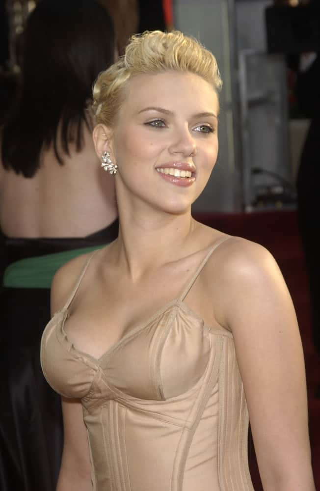 Scarlett Johansson's sexy nude dress pairs quite well with her upstyle with a tousled pompadour look at the 61st Annual Golden Globe Awards at the Beverly Hilton Hotel in Beverly Hills, CA. on January 25, 2004.