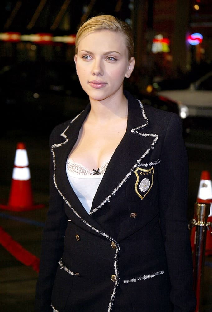 Scarlett Johansson wore a Chanel jacket to pair with her slick and neat hairstyle with a side-swept finish at the premiere of IN GOOD COMPANY held at the Grauman's Chinese Theater in Hollywood, CA on December 6, 2004.